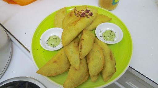 Spicy potato & callaloo corn empanadas with Trinidadian coconut chutney & hot Bajan chutney