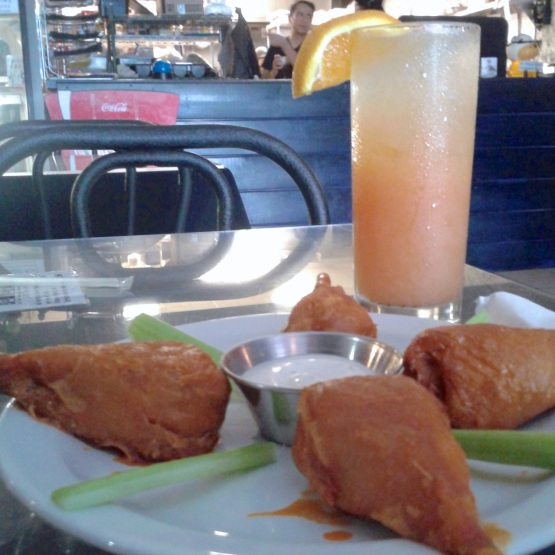 BBQ buffalo wings & a tequila sunrise